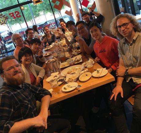 Lab team enjoying a meal together