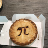 a pie with a pi symbol cut out of the crust