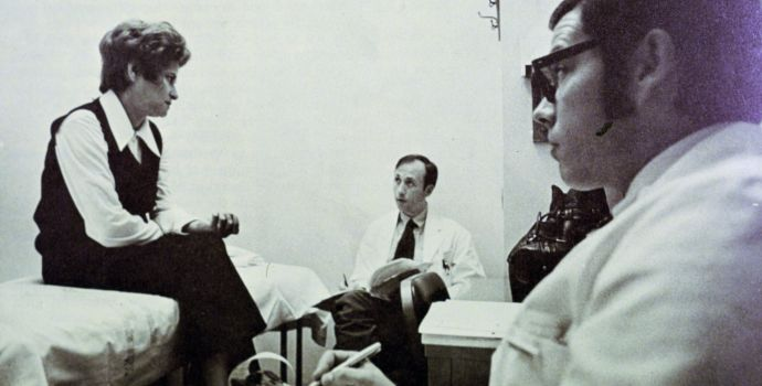 In January 1972, pharmacists consult with a patient